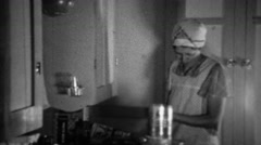 1936: Aproned women cooking in kitchen sifting flour for biscuits. Stock Footage