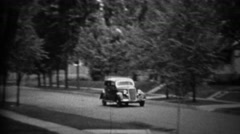 1935: Classic new black Plymouth car driving residential neighborhood. Stock Footage