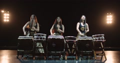 very epic performance of three Japanese Taiko drummer on stage, with sound - stock footage