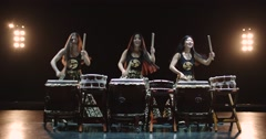 Very epic performance of three Japanese Taiko drummer on stage, with sound Stock Footage