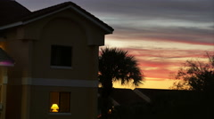 Hotel with Palm Trees at Sunset to Night Time Lapse, 4K  Stock Footage