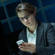 Workaholic reading message - stock photo