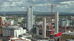 4K Panoramic view Manchester town crane machine construction site modern tower  Stock Footage