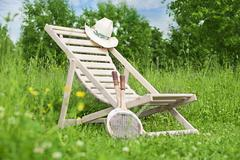 Summer still life with chaise-longue - stock photo