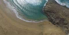 4k aerial video of a beach from above. Vertical shot. Stock Footage