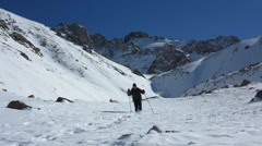 Traveler walking on snow-covered mountains Stock Footage