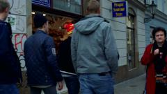 Slowmotion view on people walk in town on square Stock Footage