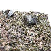 druse of green epidote crystals close up on rock - stock photo