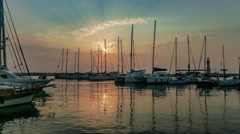Yachts moored at marina in a row under the sunrise Stock Footage