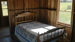 Bed in Old Cabin with Light Going Through Window, 4K Stock Footage