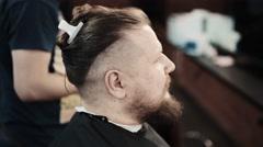 Brutal man in barbershop for hairdo Stock Footage