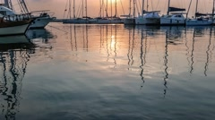 Yachts masts reflection in the sea water under the twilight Stock Footage