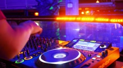 Dj mixes the track in the nightclub at party - stock footage