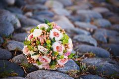 The bride's bouquet with brooch - stock photo
