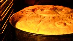 Homemade bread is baked in the oven stoves slider shoot - stock footage