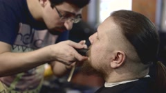 Hairdresser cutting moustache Stock Footage