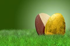 Golden Easter egg on grass on green background - stock photo