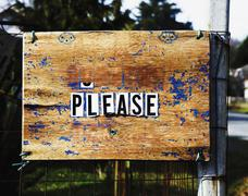 Stock Photo of Please sign on neighborhood fence
