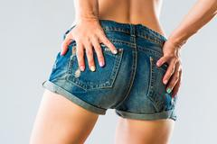 Sexy woman body in jeans shorts Stock Photos