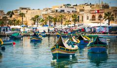 boats near fishing village of Marsaxlokk - stock photo