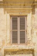 Stock Photo of white wooden window shutters