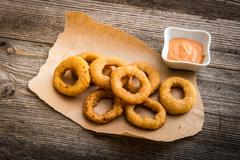 Fried onion rings with sauce Stock Photos