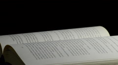 Pages of a open book with words, phrases and texts in castillian, rotating Stock Footage