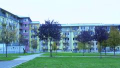 Slowmotion trees in front of block of flats Stock Footage