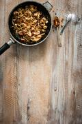Fried meat in pan on wooden table Stock Photos