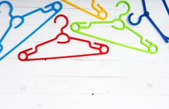 set of colorful plastic clothes hangers - stock photo