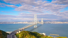 Akashi Kaikyo Bridge spanning the Seto Inland Sea from Awaji Island to Kobe, Jap - stock footage
