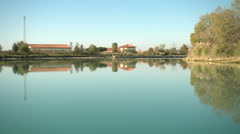 Houses on the coast of the Tagliamento river Stock Footage
