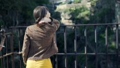 Young woman admires view from the viewpoint in spanish city Ronda - stock footage