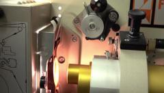 Pulling 35 mm film in professional film cinema projector, 4K video, part of set - stock footage