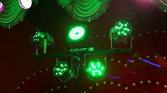 Changing green, purple, orange, red, pink, blue colors of stage lamps Stock Footage