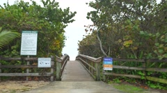 Boardwalk to the beach - stock footage