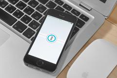 iPhone 5s with 1 Password app - stock photo