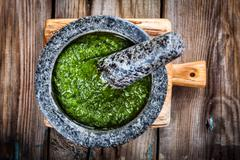 Homemade pesto in a mortar Stock Photos