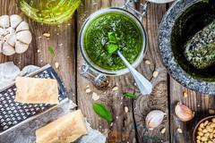homemade pesto: basil, parmesan, pine nuts, garlic, olive oil - stock photo