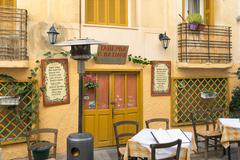 Traditional tavern at Nafplio in Greece ready to welcome people for a lunch. - stock photo