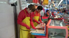 Cutting fish & marine pineapples at the Jagalchi Fish Market. Busan Stock Footage
