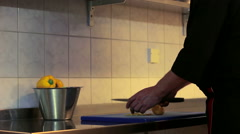 Chef cuts the vegetables with a knife in the restaurant kitchen slider shoot rr Stock Footage
