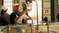 People sell fish at the Old Market in Modena, Italy. Stock Footage