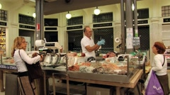 People buy fish at the Old Market in Modena, Italy. Stock Footage