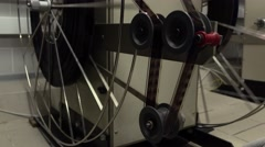 Dolly shot of moving parts in pro cinema projector, 4K video, part of set - stock footage