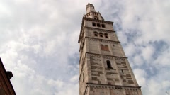 Stock Video Footage of Exterior of the Romanesque Ghirlandina bell tower in Modena, Italy.