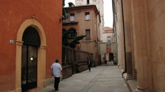 People walk by the street in Modena, Italy. Stock Footage