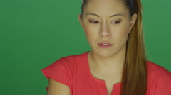 Beautiful young lady begins to cry, on a green screen background Stock Footage