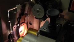 Close up dolly shot of pro film cinema projector details, 4K, part of set - stock footage