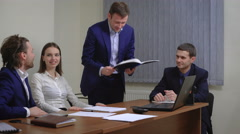 The team of young businesspeople. Rejoice success. In the office. The plan is Stock Footage